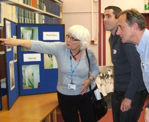 Fran Pitt showing members of staff the plans for the ward