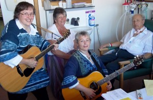 Ann Hinchliffe and Caroline David from Same Difference Dance enjoy a song with Arlo Cuss and his wife Rosemary